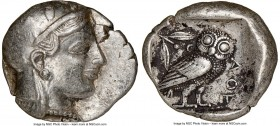 ATTICA. Athens. Ca. 465-455 BC. AR tetradrachm (26mm, 17.15 gm, 11h). NGC XF 4/5 - 2/5. Head of Athena right, wearing crested Attic helmet ornamented ...