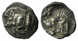Mysia, Kyzikos, c. 450-400 BC. AR Hemiobol (8.5mm, 0.44g, 9h). Forepart of boar l.; tunny to r. R/ Head of lion l.; star to l.; all within incuse squa...