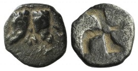 Troas, Kebren, 5th century BC. AR Hemiobol (7mm, 0.40g). Two ram's heads downward; floral ornament between. R/ Quadripartite incuse square of swastika...