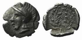 Aeolis, Elaia, c. 450-400 BC. AR Tetartemorion? (5mm, 0.12g, 9h). Helmeted head of Athena l. R/ Wreath. SNG Copenhagen 164. Good VF