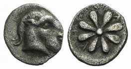 Aeolis, Kyme, 4th century BC. AR Obol (8mm, 0.63g). Head of goat r. R/ Floral pattern. Unpublished in the standard references. Good VF