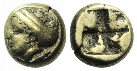 Ionia, Phokaia, c. 478-387 BC. EL Hekte – Sixth Stater (9mm, 2.53g). Female head l., hair bound in sakkos; seal to r. R/ Quadripartite incuse square. ...