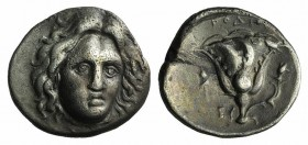 Islands off Ionia, Rhodes, c. 305-275 BC. AR Didrachm (20mm, 6.51g, 12h). Head of Helios facing slightly r. R/ Rose, bud to r.; to l., thyrsos above E...