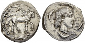 SICILY. Syracuse. Second Democracy, 466-406. Tetradrachm 460/450. Obv. Charioteer, wearing long chiton and holding kentron and reins, driving a slow q...