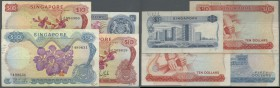 Singapore: small set with 4 Banknotes of the 'Flower' series 1967-73 with 1, 2 x 10 and 50 Dollars, P.1a, 3a,b, 5b, all with several folds, lightly st...
