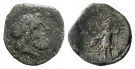Sicily, Panormos, after 200 BC. Æ (19mm, 4.15g, 1h). Laureate head of Zeus r. R/ Warrior standing l., wearing helmet and cuirass, holding phiale and s...