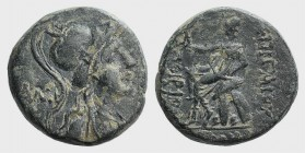 Pontos, Amisos. Æ (20mm, 7.32g, 11h). C. Caecilius Cornutus. Praetor, 56 BC. Helmeted bust of Athena or Roma r. R/ Roma seated l. on shields, holding ...