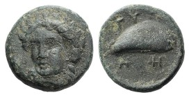 Aeolis, Gyrneion, 4th century BC. Æ (10mm, 1.66g, 5h). Laureate head of Apollo facing slightly l. R/ Mussel shell. SNG von Aulock 7689. Green patina, ...