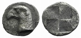 Aeolis, Kyme, c. 450-400 BC. AR Hemiobol (7mm, 0.41g). Head of eagle l.; retrograde K to l. R/ Quadripartite incuse square. SNG von Aulock 1623. VF
