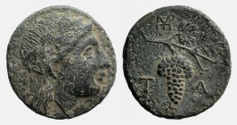 Aeolis, Temnos, 3rd century BC. Æ (17mm, 3.58g, 11h). Head of Dionysos r., wearing ivy wreath. R/ Grape bunch on vine; monogram to upper l. SNG Copenh...