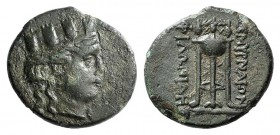 Ionia, Smyrna, c. 220-190 BC. Æ (18mm, 3.41g, 12h). Philonides, magistrate. Turreted head of Tyche r. R/ Tripod. SNG Copenhagen 1118 var. (magistrate)...