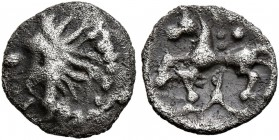 CELTIC, Central Europe. Vindelici. 1st century BC. 1/4 Quinar (Silver, 9 mm, 0.40 g), 'Manching II' type. Celticized head to left. Rev. Horse left; ab...
