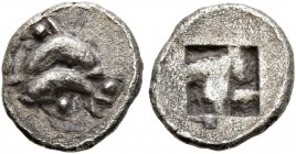 ISLANDS OFF THRACE, Thasos. Circa 500-480 BC. Obol (Silver, 9 mm, 0.53 g). Two dolphins above one another, swimming in opposite directions; pellet abo...