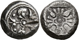 THRACO-MACEDONIAN REGION. Uncertain. Circa 500-480 BC. Stater (Silver, 17 mm, 8.60 g). Four flowers and a human head to right arrayed around central p...