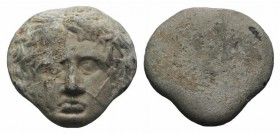 Sicily(?), 1st-3rd centuries AD. PB Plaquette or Medalette (15mm, 5.77 g). Facing head of Medusa. R/ Blank. VF