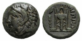 Macedon, Philippoi, c. 356-345 BC. Æ (15mm, 5.20g, 6h). Head of Herakles l., wearing lion skin. R/ Tripod; to l., corn-grain(?) above club. SNG ANS 66...