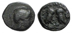 Attica, Athens, c. 322/17-307 BC. Æ (14mm, 2.72g, 6h). Helmeted head of Athena r. R/ Two owls standing confronted, heads facing, plemochoe below; all ...
