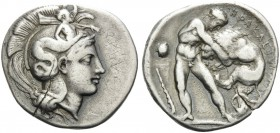 LUCANIA. Herakleia . Circa 390-340 BC. Stater (Silver, 23 mm, 7.59 g, 12 h). Helmeted head of Athena to right. Rev. ΗΡΑΚΛΕΙΩΝ Youthful Herakles wrestl...