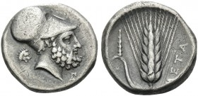 LUCANIA. Metapontum . Circa 340-330 BC. Stater (Silver, 20 mm, 7.66 g, 11 h). Helmeted head of Leukippos to right; to left, lion's head; below chin, m...