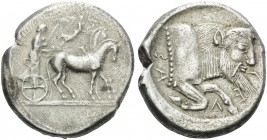 SICILY. Gela . Circa 480/75-475/70 BC. Tetradrachm (Silver, 27 mm, 16.55 g, 4 h). Quadriga driven slowly to right by a bearded charioteer; above, Nike...