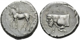SICILY. Gela . Circa 420-415 BC. Tetradrachm (Silver, 25 mm, 17.24 g, 9 h). Charioteer, driving quadriga to left. Rev. ΓEΛAΣ Forepart of man-headed bu...