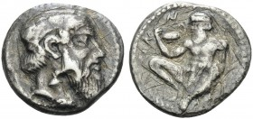 SICILY. Naxos . Circa 461-430 BC. Drachm (Silver, 17 mm, 3.97 g, 7 h). Bearded head of Dionysos to right. Rev. NAXION Silenos, nude and bearded, squat...