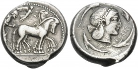 SICILY. Syracuse . Deinomenid Tyranny, 485-466 BC. Tetradrachm (Silver, 24 mm, 17.32 g, 1 h). Charioteer driving a quadriga walking to right; above Ni...