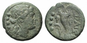Northern Lucania, Paestum, 218-201 BC. Æ Triens (16mm, 3.68g, 6h). Female head r. wearing ivy wreath; four pellets to l. R/ Cornucopia; four pellets a...