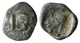 Mysia, Kyzikos, c. 450-400 BC. AR Hemiobol (7mm, 0.27g, 1h). Forepart of boar r.; tunny to l. R/ Head of roaring lion l., retrograde K to l.; all with...