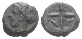 Sicily, Syracuse, c. 415-405 BC. Æ Hemilitron (14mm, 3.58g, 1h). Head of Arethusa l., hair in sphendone. R/ Wheel of four spokes; dolphins in lower qu...