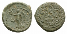 Macedon, Thessalonica, AD 96-117. Æ (146mm, 3.70g, 1h). Nike standing l. on globe, holding wreath and palm; crescent to l. R/ Legend in four lines wit...