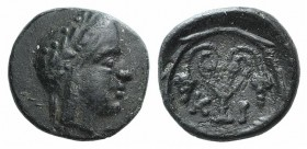 Bithynia, Kios, c. 3rd century BC. Æ (11mm, 1.24g, 12h). Head of Mithras r., wearing a laureate tiara. R/ Kantharos with two grape vines within wreath...