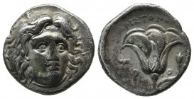 Caria, Rhodes. ca.275-250 BC. AR Didrachm (18mm, 6.40g). Aristonomos, magistrate. Head of Helios facing slightly right. / P-O across field, rose with ...