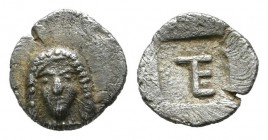 Ionia, Kolophon. ca.525-490 BC. AR Tetartemorion (7mm, 0.27g). Facing laureate head of Apollo. / TE monogram within incuse square. SNG Kayhan 356, Slg...