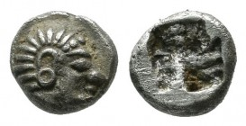 Ionia, Kolophon. ca.530-500 BC. AR Tetartemorion (5mm, 0.42g). Archaic head of Apollo right. / Incuse square punch. SNG Kayhan 352.