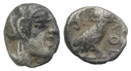 Attica, Athens, c. 454-404 BC. AR Obol (7.5mm, 0.66g, 3h). Helmeted head of Athena r. R/ Owl standing r., head facing; olive sprig and crescent behind...