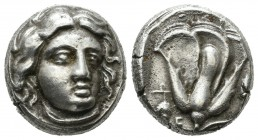 Caria. Rhodes, (Mid-late 4th century BC). AR Didrachm (16mm, 6.89g). Head of Helios facing slightly right / ΡΟΔΙΩΝ. Rose with bud to right; grape bunc...