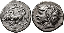 SICILY. Kamarina. Circa 415-405 BC. Tetradrachm (Silver, 27 mm, 16.89 g, 9 h). Charioteer driving quadriga galloping to left, holding the reins with h...