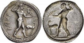 Bruttium, Caulonia. Nomos circa 525-500, AR 7.95 g. KAVΛ Apollo, diademed, walking r., holding laurel branch in upraised r. hand and small running dai...
