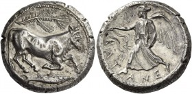 Catana. Tetradrachm circa 464-450, AR 17.30 g. The river-god Amenanos as bearded, man-headed bull r., r. leg bent at knee; above, branch and below, fi...