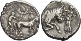 Gela. Tetradrachm circa 440-430, AR 17.32 g. Slow quadriga driven r. by charioteer holding kentron and reins; above, Nike flying r. to crown the horse...