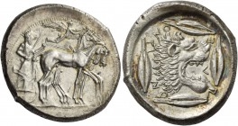 Leontini. Tetradrachm circa 475, AR 16.97 g. Slow quadriga driven r. by charioteer, holding reins and kentron; in field above, Nike flying r. to crown...