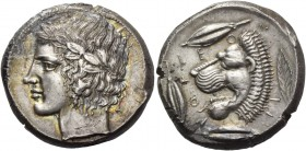 Leontini. Tetradrachm circa 430-425, AR 17.35 g. Laureate head of Apollo l. Rev. LEO – N – TI – NON Lions' head l., with open jaws and protruding tong...