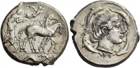 Syracuse. Tetradrachm circa 460-440, AR 17.39 g. Slow quadriga driven r. by charioteer, holding kentron and reins; above, Nike flying r. to crown hors...