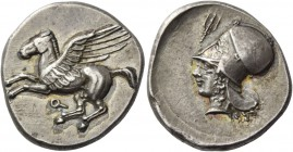 Corinthia, Corinth. Stater circa 410-380, AR 8.51 g. Pegasus flying r.; below, ?. Rev. Head of Athena l., wearing Corinthian helmet; above, trident up...