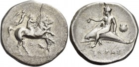 Calabria, Tarentum. Nomos circa 340-335 BC, AR 7.40 g. Horse rearing r., restrained at neck by groom. Rider crowned by Nike. Rev. Dolphin rider l., ho...