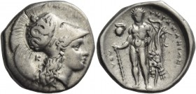 Lucania, Heraclea. Nomos circa 330-320 BC, AR 7.78 g. Head of Athena r., wearing helmet decorated with Scylla hurling stone; behind neck, K. Rev. Hera...
