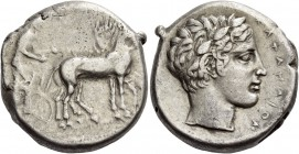 Catana. Tetradrachm circa 425-420 BC, AR 16.83 g. Slow quadriga driven r. by charioteer. Rev. Laureate head of Apollo r., with short hair. Boehringer,...