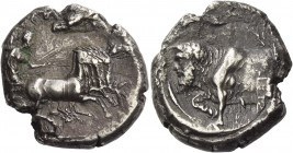 Gela. Tetradrachm circa 415-405, AR 16.28 g. [ΓΕ - ΛΩ - ΙΩ - Ν] Fast quadriga driven r. by Nike, holding kentron and reins; above eagle flying r. and,...