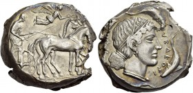Syracuse. Tetradrachm circa 460-440 BC, AR 17.25 g. Slow quadriga driven r. by charioteer, holding kentron and reins; above, Nike flying r., crowning ...